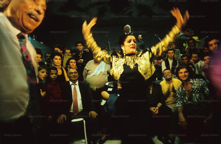 A Gitan woman dances to rhumba music, during Kaly's wedding celebrations. Figuerolles, France 1994