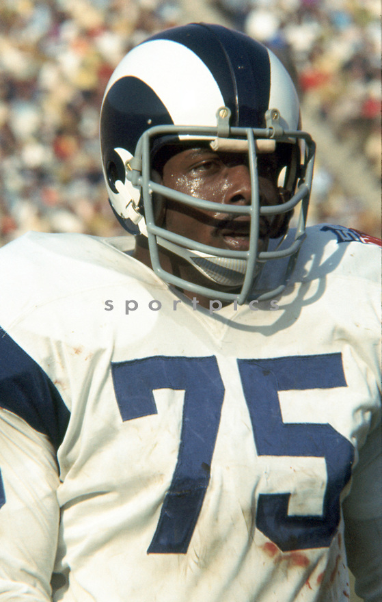 Los Angeles Rams Deacon Jones (75) during a game from his career with the Los Angeles Rams. Deacon Jones played for 14 years with 3 different teams , was a 8-time Pro Bowler and was inducted to the Pro Football Hall of Fame in 1980.(SportPics)
