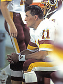 Washington Redskins quarterback Mark Rypien (11) watches the action during a pre-season game against the Miami Dolphins at RFK Stadium in Washington, D.C. on August 25, 1989.  The Redskins won the game 35 - 21.<br /> Credit: Arnold Sachs / CNP