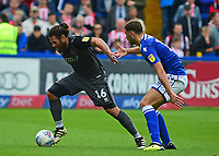 Lincoln City's Michael Bostwick brings the ball out of defence under pressure from  Macclesfield Town's Harry Smith<br /> <br /> Photographer Andrew Vaughan/CameraSport<br /> <br /> The EFL Sky Bet League One - Macclesfield Town v Lincoln City - Saturday 15th September 2018 - Moss Rose - Macclesfield<br /> <br /> World Copyright &copy; 2018 CameraSport. All rights reserved. 43 Linden Ave. Countesthorpe. Leicester. England. LE8 5PG - Tel: +44 (0) 116 277 4147 - admin@camerasport.com - www.camerasport.com