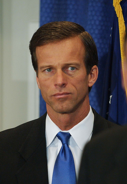 "11/15/04.SENATE GOP FRESHMEN OF 109TH CONGRESS--John Thune, South Dakota, during a news conference with NRSC Chairman Sen. George Allen, R-Va., at NRSC headquarters. Allen gave each Senator-elect a ""game ball"" for winning their respective campaigns. .CONGRESSIONAL QUARTERLY PHOTO BY SCOTT J. FERRELL"