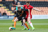 Jack Taylor of Barnet holds off Sam Jones of Grimsby Town during the Sky Bet League 2 match between Barnet and Grimsby Town at The Hive, London, England on 29 April 2017. Photo by David Horn.