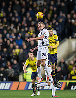 Steve Morison of Millwall beats Jake Wright of Oxford United in the air during the Johnstone's Paint Trophy Southern Final 2nd Leg match between Oxford United and Millwall at the Kassam Stadium, Oxford, England on 2 February 2016. Photo by Andy Rowland / PRiME Media Images.