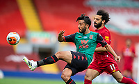 5th July 2020, Anfield, Liverpool, England;  Aston Villa s Neil Taylor clears the ball under pressure from Liverpools Mohamed Salah during the Premier League match between Liverpool and Aston Villa at Anfield in Liverpool