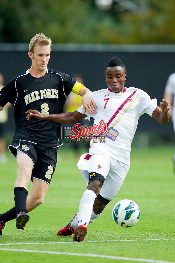Derrick Boateng (7) of the Boston College Eagles tries to keep the ball away from Jared Watts (2) of the Wake Forest Demon Deacons at Spry Soccer Stadium on October 6, 2012 in Winston-Salem, North Carolina.  The Eagles defeated the Demon Deacons 1-0.  (Brian Westerholt/Sports On Film)