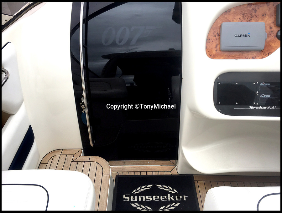 BNPS.co.uk (01202 558833)<br /> Pic :  TonyMichael/BNPS<br /> <br /> The Sunseeker even has a 007 logo on the cabin hatch.<br /> <br /> A James Bond fan has bought the late Sir Roger Moore's former luxury speedboat for £90,000.<br /> <br /> Car sales business owner Tony Michael could not believe his luck when he found out the beloved 007 actor's stylish Sunseeker Tomahawk 41 was on the market.<br /> <br /> Moore, who played Bond in seven films, owned the 41ft boat from new in 1995 until 2007 and ran it along the French Riviera.<br /> <br /> He was often photographed on it in the millionaires' playground of Monaco where he had an apartment.