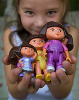 Young girl holds Dora the Explorer dolls after some of the toys were recalled during to lead in the paint.