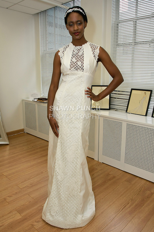 """Model poses in """"Cilo"""" - a cap sleeve taffeta gown with guipure lace insets, from the Sarah Jassir Fall 2013: From Concept To Creation collection, for her Angelique Bridal store opening at 6 East 45 Street, during New York Bridal Fashion Week, October 15, 2012"""