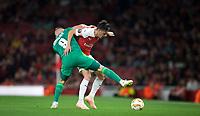 Mesut Özil of Arsenal battles Mykhaylo Serhiychuk of Vorskla Poltava during the UEFA Europa League match group between Arsenal and Vorskla Poltava at the Emirates Stadium, London, England on 20 September 2018. Photo by Andrew Aleks / PRiME Media Images.
