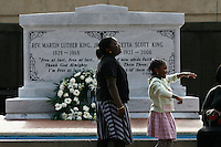 Brianna Brown (left), 12, and her sister Chantelle, 9, along with their mother, visit the tomb of Dr. Martin Luther King Jr. and his wife, Coretta Scott King, at the Martin Luther King Jr. National Historic Site.<br />