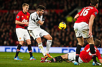 Saturday 11 January 2014 Pictured: Alejandro Pozuelo's shot is rebounded as he tries in vain to score for the Swans<br /> Re: Barclays Premier League Manchester Utd v Swansea City FC  at Old Trafford, Manchester