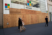 NEW YORK, NEW YORK - JUNE 08: A Microsoft store is boarded up on June 08, 2020 in New York City. The City began first phase of reopening after nearly three months of shutdown , also Protests continue over black Americans abuse by the Police (Photo by Kena Betancur/VIEWpress via Getty Images)