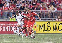 MLS action a at BMO Field between the New England Revolution and Toronto FC. The game ended in a 1-1 draw.