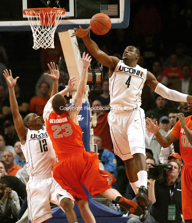 UConn's Jeff Adrien blocks a shot by Syracuse's Eric Devendorf while A.J. Price blocks the lane during their 127-117 loss to Syracuse  in 6 overtimes in the Big East tournament Thursday at Madison Square Garden in New York City.<br /> Jim Shannon Republican-American