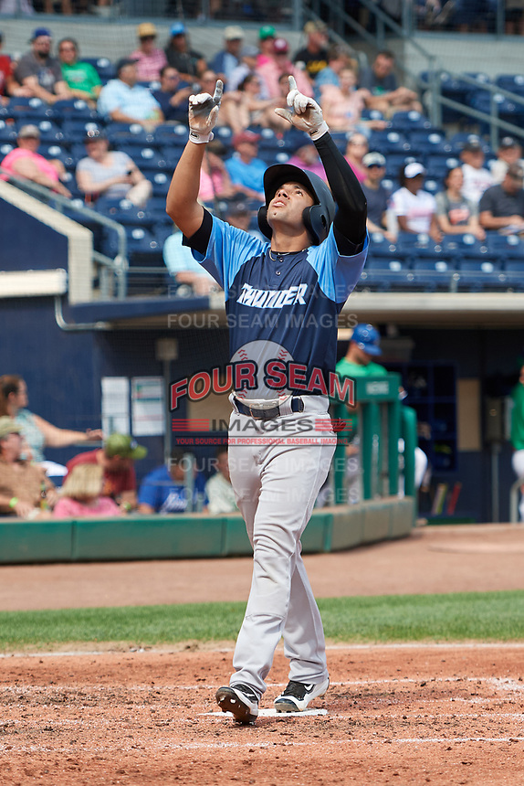 Trenton Thunder third baseman Danienger Perez (3) points skyward as he crosses home plate after hitting a home run in the top of the fourth inning during a game against the Hartford Yard Goats on August 26, 2018 at Dunkin' Donuts Park in Hartford, Connecticut.  Trenton defeated Hartford 8-3.  (Mike Janes/Four Seam Images)