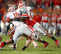 Ohio State Buckeyes linebacker Joshua Perry (37) tackles Clemson Tigers quarterback Tajh Boyd (10) in the 1st quarter of their game against Clemson Tigers in the Discover Orange Bowl at Sun Life Stadium in Miami Gardens, Florida on January 3, 2014.(Dispatch photo by Kyle Robertson)