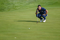 Rory McIlroy (Team Europe) lines up his putt on 9 during Friday's foursomes of the 2018 Ryder Cup, Le Golf National, Guyancourt, France. 9/28/2018.<br /> Picture: Golffile | Ken Murray<br /> <br /> <br /> All photo usage must carry mandatory copyright credit (&copy; Golffile | Ken Murray)