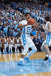 Cameron Johnson (13) of the North Carolina Tar Heels passes the ball after grabbing a rebound during first half action against the Wake Forest Demon Deacons at the Dean Smith Center on December 30, 2017 in Chapel Hill, North Carolina.  The Tar Heels defeated the Demon Deacons 73-69.  (Brian Westerholt/Sports On Film)