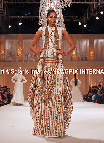 "Mumbai, India-06/03/2012: LAKME FASHION WEEK.Creation from designer Rohit Bal at the LFW Summer/Resort 2012 fashion collection, during Lakme Fashion Week 2012 in Mumbai, India..Mandatory Photo Credit: ©Srinivas Akella-Solaris Images/NEWSPIX INTERNATIONAL..**ALL FEES PAYABLE TO: ""NEWSPIX INTERNATIONAL""**..PHOTO CREDIT MANDATORY!!: NEWSPIX INTERNATIONAL(Failure to credit will incur a surcharge of 100% of reproduction fees)..IMMEDIATE CONFIRMATION OF USAGE REQUIRED:.Newspix International, 31 Chinnery Hill, Bishop's Stortford, ENGLAND CM23 3PS.Tel:+441279 324672  ; Fax: +441279656877.Mobile:  0777568 1153.e-mail: info@newspixinternational.co.uk"