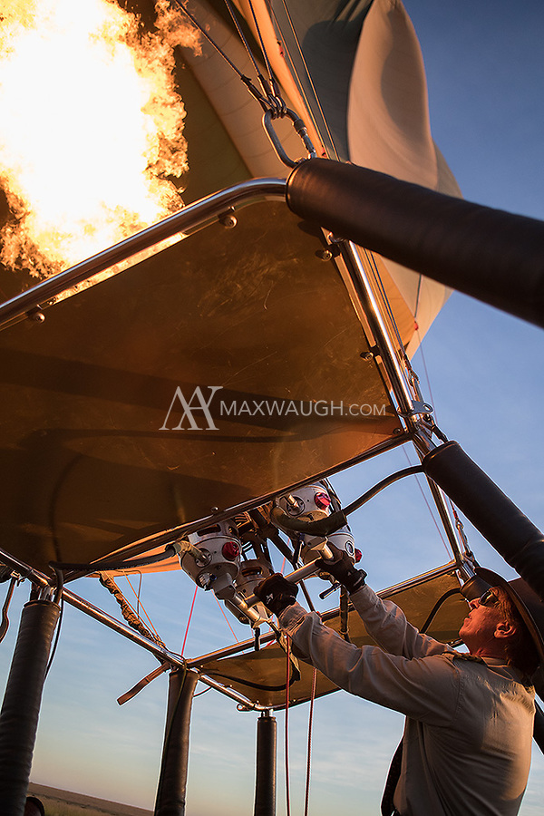 One of the highlights of this trip was a hot air balloon ride over the Serengeti. Our captain uses the flame to continue inflating the hot air balloon prior to launch.