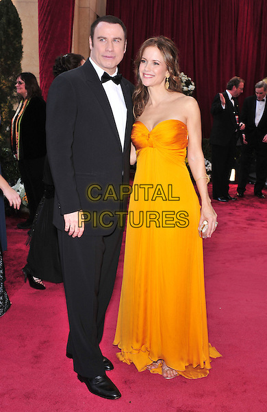 JOHN TRAVOLTA & KELLY PRESTON.The 80th Annual Academy Awards arrivals held at the Kodak Theatre, Hollywood, California, USA. .February 24th, 2008.oscars full length black tuxedo orange yellow strapless dress married husband wife .CAP/ADM/GB.©Gary Boas/AdMedia/Capital Pictures.