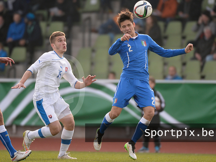 20150323 - MARBURG , GERMANY  : Italian Giuseppe Scalera (right) pictured heading the ball in front of Slovakian Denis Nemcek (left) during the soccer match between Under 17 teams of Slovakia and Italy , on the second matchday in group 8 of the UEFA Elite Round Under 17 at Georg-Gassmann , Marburg Germany . Monday 23 rd  March 2015 . PHOTO DAVID CATRY