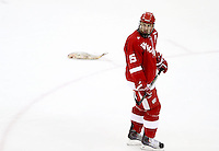 Wisconsin's Craig Smith skates by a fish after UNO's first goal. Each game a frozen fish is tossed onto the ice after the first UNO goal. No. 16 UNO beat No. 7 Wisconsin 4-3 Saturday night at Qwest Center Omaha. (Photo by Michelle Bishop)