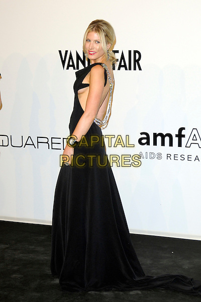 HOFIT GOLAN.The amfAR Gala at La Permanente during the Mailand Fashion Week Spring/Summer 2010 - Milan, Italy. .September 28th, 2009.full length black dress maxi backless looking over shoulder silver chain skin breast boob flashing .CAP/RD.©Richard Dean/Capital Pictures.