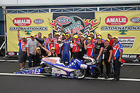 Mar. 17, 2013; Gainesville, FL, USA; NHRA pro stock motorcycle rider Hector Arana Jr celebrates with family and crew after winning the Gatornationals at Auto-Plus Raceway at Gainesville. Mandatory Credit: Mark J. Rebilas-
