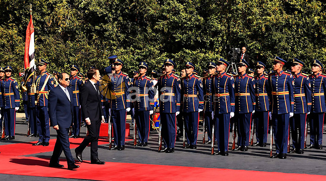 Egyptian President Abdel Fattah al-Sisi inspects an honour guard with French President Emmanuel Macron at the presidential palace Cairo, Egypt, January 28, 2019 in this handout picture courtesy of the Egyptian Presidency. Photo by Egyptian President Office \ apaimages