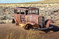 An old car serves as a monument to the travelers of Route 66 in the Petrified Forest National Park.