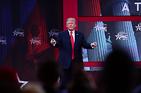 National Harbor, MD - February 23, 2018: President Donald J. Trump acknowledges attendees of the Conservative Political Action Conference (CPAC) at the Gaylord National Hotel in National Harbor, MD, February 23, 2018.  (Photo by Don Baxter/Media Images International)