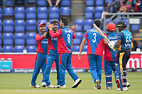 Rashid Khan (Afghanistan) celebrates with Rahmat Shah (Afghanistan) as Kusal Perera (Sri Lanka) departs during Afghanistan vs Sri Lanka, ICC World Cup Cricket at Sophia Gardens Cardiff on 4th June 2019
