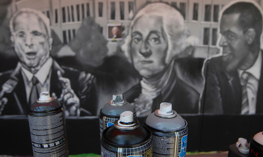 14 August 08: Spray paint is used to create a mural of past and current leaders on the side of a downtown Denver business. In advance of the 2008 Democratic National Convention, local artists create a mural featuring past, current, and future local, national, and world leaders, on the side of a local business, Snooze, in Denver, Colorado. According to a Snooze employee, the work is a collaboration of the Colorado Democratic Party, the Cuty of Denver, and Snooze, a breakfast restaurant in Lower Downtown Denver (LoDo). The mural features the likenesses of John McCain, George Washington, Barack Obama, Thomsa Jefferson, Denver mayor John Hickenlooper, and the Dalai Lama, together at a single breakfast table.