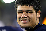 Nevada's Ian Seau talks with teammates on the sidelines of an NCAA college football game in Reno, Nev., on Saturday, Nov. 16, 2013. (AP Photo/Cathleen Allison)