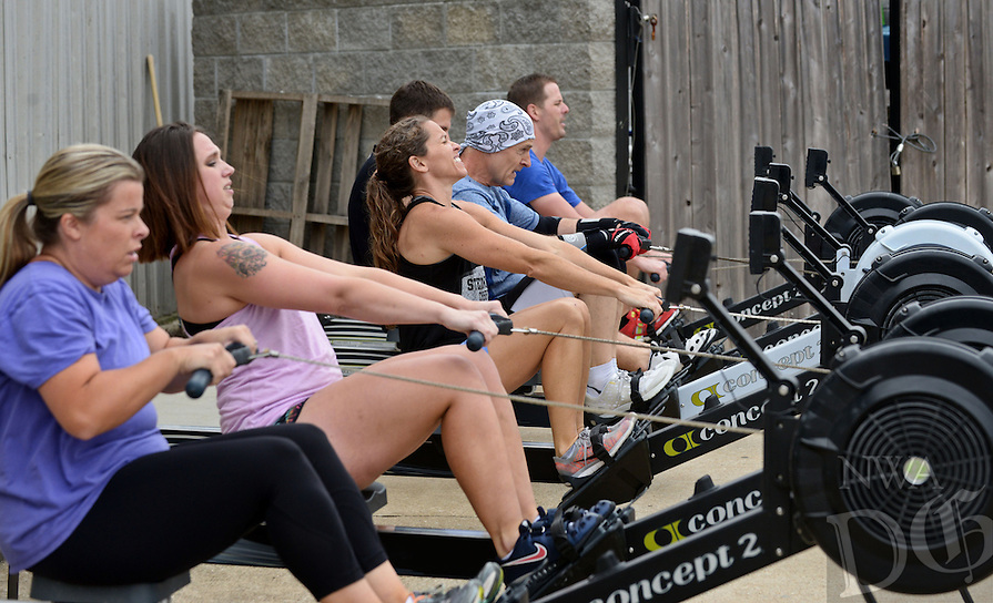 NWA Democrat-Gazette/BEN GOFF @NWABENGOFF<br /> Members workout on rowing machines on Monday Oct. 5, 2015 at Bear State CrossFit in Bentonville. Rowing was part of the CrossFit box's Workout of the Day.