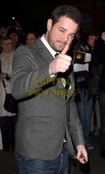 Danny Dyer .The 'Deviation' UK film premiere, Odeon Covent Garden cinema, Shaftesbury Avenue, London, England..February 23rd, 2012.half length grey gray suit jacket hand thumb up stubble facial hair .CAP/ROS.©Steve Ross/Capital Pictures.