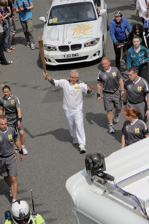 Olympic torch as it makes it's way into Falmouth High street. Cornwall 19/05/2012