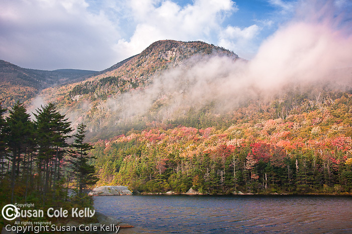 Morning fog streams over Mount Blue in Kinsman Notch, Woodstock, White Mountains, NH