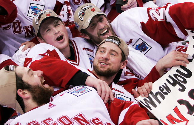 (from left) Junior goalie Brian Elliott, freshman forward Jack Skille, junior forward Ross Carlson and senior forward captain Adam Burish dog pile in celebration at the end of the on-ice festivities following the Badger?s win of the 2006 college national hockey championship over.