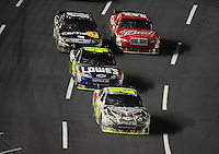 Oct. 17, 2009; Concord, NC, USA; NASCAR Sprint Cup Series driver Jeff Gordon (24) leads Jimmie Johnson (48), Matt Kenseth (17) and Kasey Kahne (9) during the NASCAR Banking 500 at Lowes Motor Speedway. Mandatory Credit: Mark J. Rebilas-