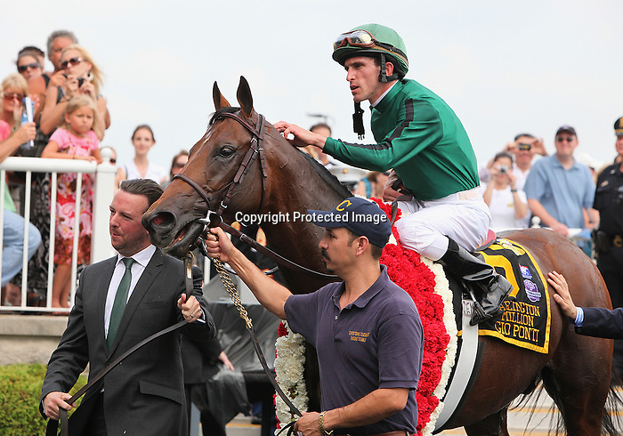 8 August 2009: GIO PONTI and jockey Ramon A. Dominguez walk into the winner's circle after winning the 27th running of the G1 Arlington Million at Arlington Park in Arlington Heights, Illinois.