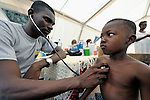 Dr. Gaspar Gaston attends patients in a tent clinic set up on a street in Jacmel, a town on Haiti's southern coast that was ravaged by the January 12 earthquake.