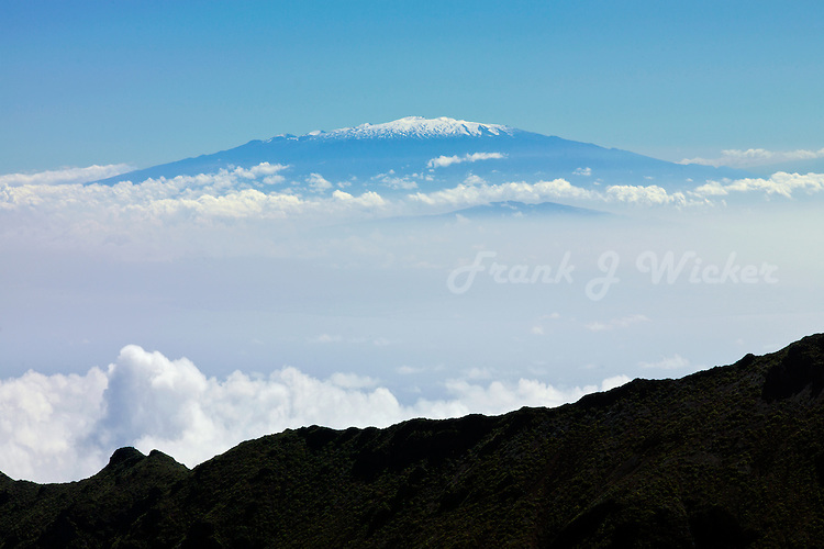 View of snow capped Mauna Kea on the Big Island of Hawaii from HALEAKALA NATIONAL PARK on Maui