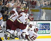 Pat Mullane (BC - 11), Tommy Cross (BC - 4), Jimmy Hayes (BC - 10), Brian Dumoulin (BC - 2) and Chris Kreider (BC - 19) celebrate Cross's game winning goal. - The Boston College Eagles defeated the Boston University Terriers 3-2 (OT) in their Beanpot opener on Monday, February 7, 2011, at TD Garden in Boston, Massachusetts.