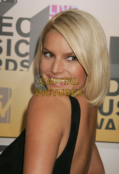 JESSICA SIMPSON.Arrivals - 2006 MTV Video Music Awards held at Radio City Music Hall, New York City, New York, USA,.31 August 2006..portrait headshot looking back over shoulder bob black dress .Ref: ADM/RE.www.capitalpictures.com.sales@capitalpictures.com.©Russ Elliot/AdMedia/Capital Pictures.