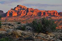 Sunset light on Elephant Butte in Arches National Park, Moab, Utah.