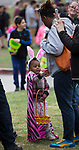 Two-year old Anaya, with mom Stephanie, during the Community Easter Egg Dash at Idlewild Park in Reno, Nevada on Saturday, March 31, 2018.