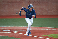 Mitch Farris (15) of the Wingate Bulldogs hustles down the first base line against the Concord Mountain Lions at Ron Christopher Stadium on February 1, 2020 in Wingate, North Carolina. The Bulldogs defeated the Mountain Lions 8-0 in game one of a doubleheader. (Brian Westerholt/Four Seam Images)