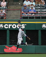 Seattle Mariners OF Wladimir Balentien leaps for a ball against the Texas Rangers on May 14th, 2008 at Texas Rangers Ball Park. Photo by Andrew Woolley / Four Seam Images.